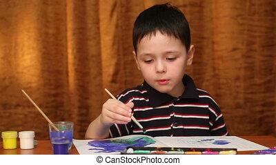child draws paints 1