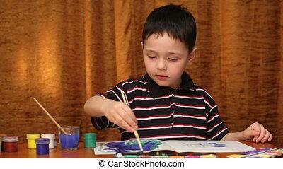child draws paints 2