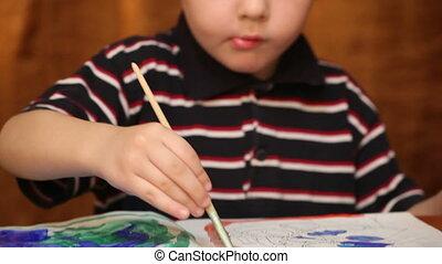 child draws paints 3