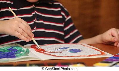 child draws paints 4
