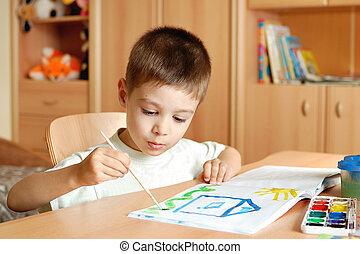 Child draws paints in children's room