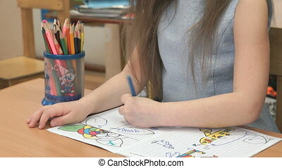 Child draws the pictures in the copybook indoors - Child...