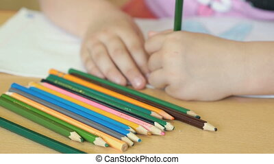 Child draws the pictures in the copybook