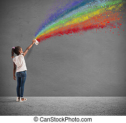 Child draws with spray the color of peace