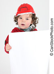 Child dressed as a builder with a blank board