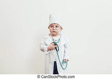 Child dressed as a doctor holding a stethoscope