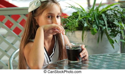 Child Drinking Cola - Little girl drinking cola in a fast...