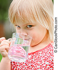 Child drinking water - Cute little girl drinking water...