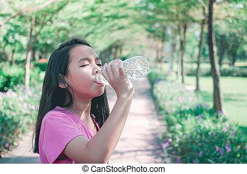 Child in bikini sliding water park. Happy kid little girl ...