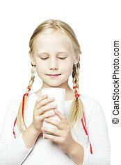 Child drinks milk, little girl with glass of milk