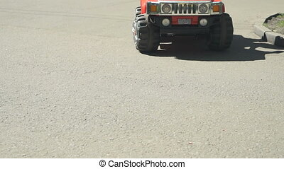 Child driving the small toy car in attraction park - Child...