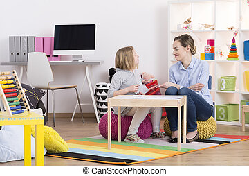 Child during play therapy - Child with pedagogue during the...