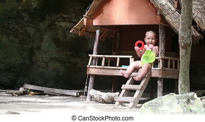 child eat in house jungle