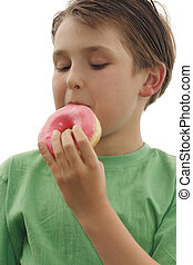 Child eating a doughnut