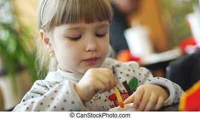 Child eating a potato