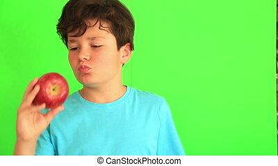 Child eating apple on chroma key background