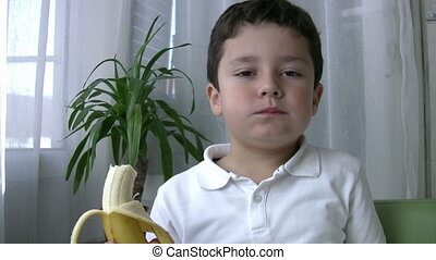 Child eating banana