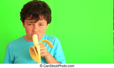 Child eating banana on chroma key background