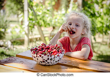 child eating cherry fruit