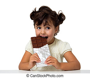 child eating chocolate - little girl eating chocolate...