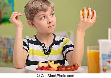 Child eating healthy breakfast
