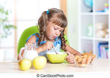 child eating healthy food in nursery