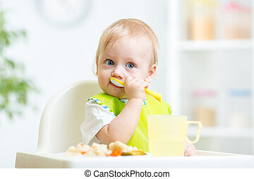 child eating healthy food