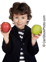 Child eating two apples