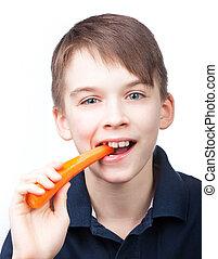 Child eats carrot