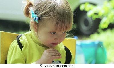 Child eats cucumber