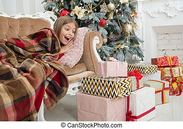 Child enjoy the holiday. Beat the Christmas rush. The morning before Xmas. Little girl. Christmas tree and presents. Happy new year. Winter. xmas online shopping. Family holiday