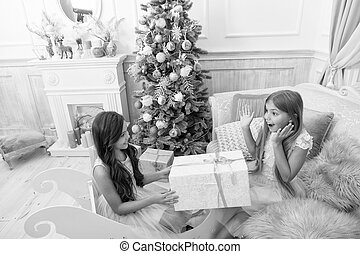 Child enjoy the holiday. The morning before Xmas. Little girls. Christmas tree and presents. Happy new year. Winter. xmas online shopping. Family holiday. Unexpected surprise