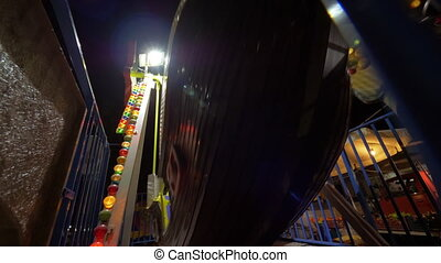 Child entertaining with pirate boat ride at fun fair - Slow...