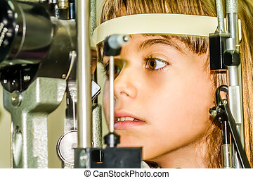 Child eye exam test - Seven year old girl is taking the eye...