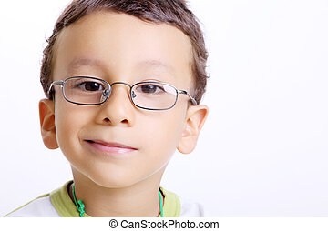 Child face - happy child with glasses and an expression of ...