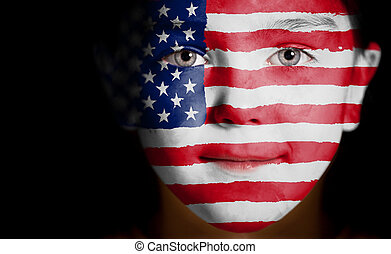Child face painted with the flag of USA.
