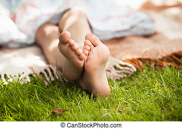 child feet on green grass - Closeup photo of child feet on...