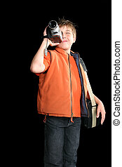 Child filming with digital video camera - Video production...