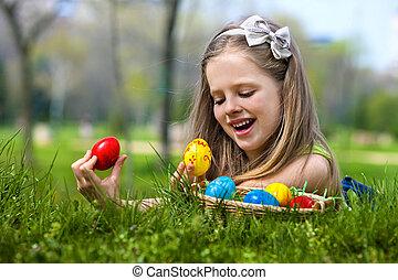 Child find easter egg outdoor. - Happy child find easter egg...