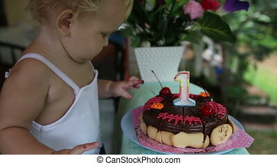 child first saw cake for my birthday for a year with cherries with candle