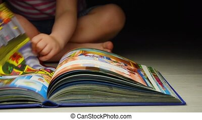 Child flipping book