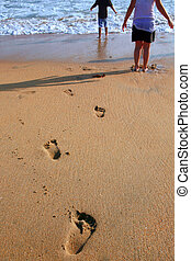 Footprints of children leading into the Ocean