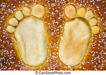 Child footprints on bap. Celebration ot child birthday.