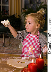 Child for Christmas during Advent at bake cookies