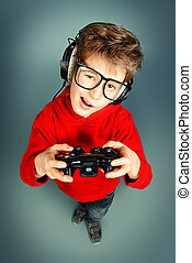 child gamer - Funny boy gamer with a controller and...