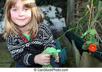 child garden gardening flower