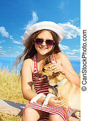 child gently embracing a dog