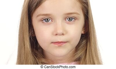 Child genuinely smile at the camera. White background. Close...