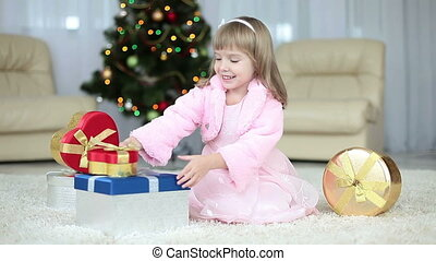 Child gets a gift from the box.