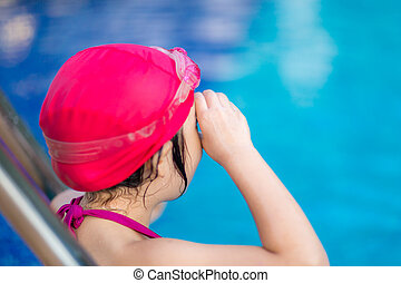 Child Getting Ready for Competition in Swimming